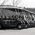 A line of golf carts ready for a day on the course